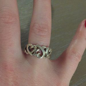 Silver ring with 3 hearts